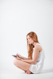 Girl with e-book Stock Images