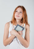 Girl with e-book Royalty Free Stock Photos