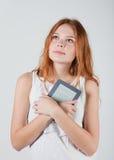 Girl with e-book Royalty Free Stock Photos