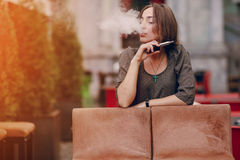 Girl with E-cigarette Royalty Free Stock Images
