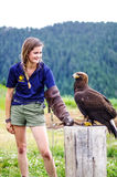 A girl and an eagle Stock Images