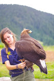 A girl and an eagle. Shoot on the summit of Grouse Mountain, Vancouver, Candada Stock Images