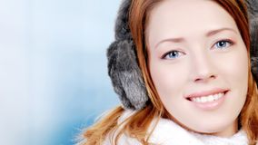 Girl with ear flaps. Portrait of beautiful young woman wearing ear flaps Stock Photography