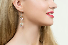 Girl ear in jewelry earrings close up Royalty Free Stock Photos