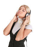 The girl in ear-phones Stock Images