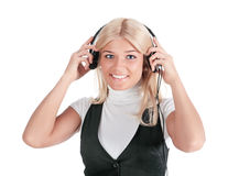 The girl in ear-phones. The happy girl in ear-phones, isolated on a white background stock photo