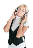 The girl in ear-phones Royalty Free Stock Photo