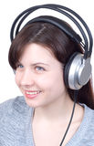 The girl in ear-phones Royalty Free Stock Photos