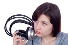 The girl in ear-phones Stock Photos