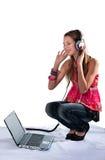 The girl in ear-phones Stock Photo