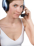 The girl in ear-phones. Portrait of the young girl in ear-phones on a white background Royalty Free Stock Image