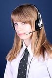 girl in ear-phones and a blouse with a tie Stock Image