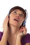 Girl in ear-phones listens to music Royalty Free Stock Images