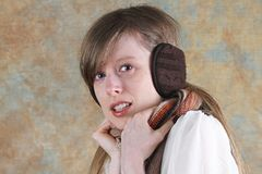 Girl with earmuffs Stock Photography