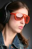 Girl in earphone Stock Photos