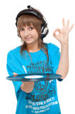 Girl in earphone Stock Image