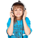 Girl in earphone smiles, portrait Royalty Free Stock Images