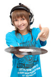 Girl in earphone with vinyl disk in hand Stock Photos