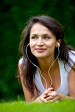 Girl with earphones outdoors Royalty Free Stock Images