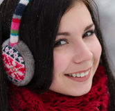 Girl in earplugs outdoors in winter Stock Image