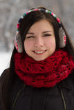 Girl in earplugs outdoors in winter Royalty Free Stock Photography