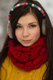 Girl in earplugs outdoors in winter Royalty Free Stock Images
