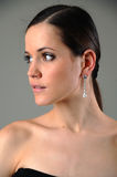 Girl with earrings Royalty Free Stock Images