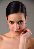 Girl with earrings Royalty Free Stock Image