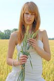 Girl with ears of wheat Royalty Free Stock Image