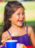 Girl Earting Cake Royalty Free Stock Photos