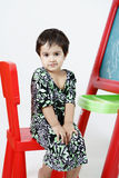 Girl on easel Stock Images