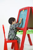 Girl on easel Stock Photo
