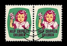 Help Crippled children. Girl with Easrer lily. Easter Seals Stamp aka Christmas seals since 1919, USA, circa 1950,. USA - CIRCA 1950s: canceled stamp printed in Stock Photography