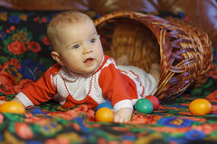 Girl in Easter basket. In bright clothes Stock Image