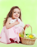 Girl with Easter basket and bunny. Curly little girl with Easter basket and white bunny in hands Stock Photos