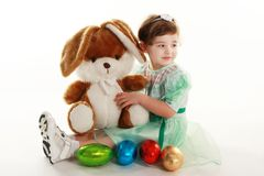 Girl and the Easter Bunny. Girl and colorful easter eggs Stock Image