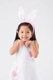 Girl in Easter bunny ears. Smiling little girl wearing Easter bunny ears Stock Photo