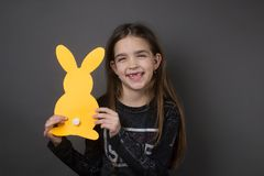 Girl easter bunny happiness isolated. Little cute happy girl easter yellow bunny happiness isolated studio Royalty Free Stock Images