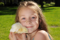 Girl with the Easter chick Stock Images