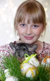 Girl with Easter decorations and chinchilla Stock Photography
