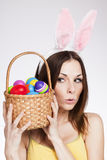 Girl with easter egg basket. Beautiful young Brunette holding easter egg basket Royalty Free Stock Images