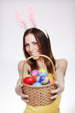 Girl with easter egg basket. Brunette smiling and holding easter egg basket Royalty Free Stock Photo