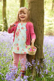 Girl On Easter Egg Hunt In Bluebell Woods Royalty Free Stock Photography