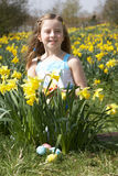 Girl On Easter Egg Hunt In Daffodil Field Royalty Free Stock Photography