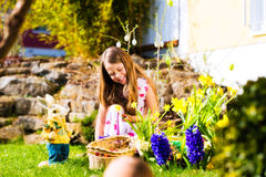 Girl on Easter egg hunt with eggs Stock Photos