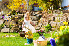 Girl on Easter egg hunt with eggs Stock Image