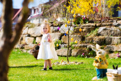 Girl on Easter egg hunt with eggs Royalty Free Stock Photo