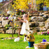 Girl on Easter egg hunt with eggs Stock Photography