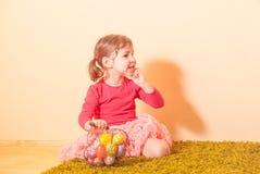 Girl on an Easter Egg hunt Stock Image