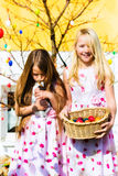 Girl on Easter egg hunt with living Easter Bunny Royalty Free Stock Image